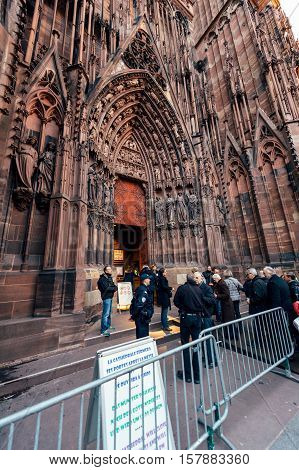 STRASBOURG FRANCE - DEC 06 2015: Armed security military forces at the entrance of the Notre-Dame de Strasbourg Cathedral checking every person before entrance - security measures after Paris Atacks