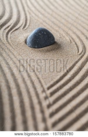 zen garden with raked sand and a smooth stone