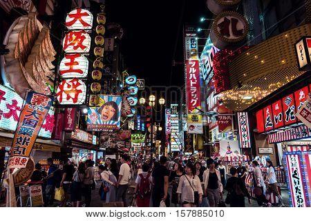 Osaka - July 2016: Night street view with people and glowing decorations. Dotonbori