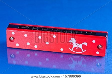 a painting harmonica isolated background music object wood red