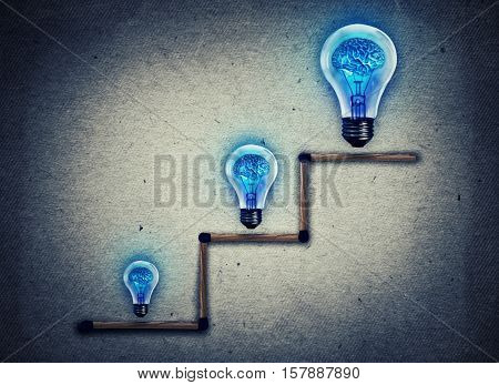 Set of matches stacked in a staircase with bulbs of different dimensions as a metaphor for business education growth and career opportunities. Way to success and idea development concept.