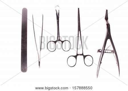 Retro collection surgical tool set. Forceps, clamps, scissors for surgery - isolated on white background