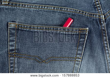 UMEA, SWEDEN ON DECEMBER 03, 2014. Illustration, a pair of blue jeans and a carpenter's pencil in a pocket on December 03, 2014 in Umea, Sweden. Well used pants, wooden red pencil. Illustrative editorial.