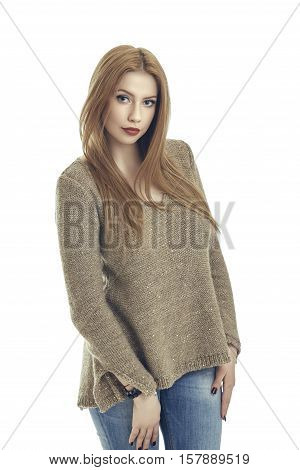 Charming Woman In Sweater And Blue Jeans