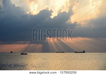 Sunset in Trieste harbour with cloudy skies - Italy