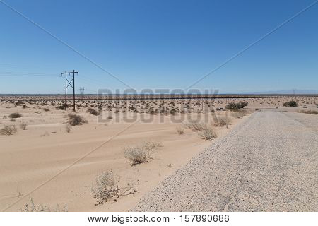 fence dividing the desert between USA and Mexico in California near Arizona