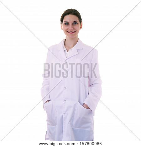 Smiling female doctor assistant scientist in white coat over white isolated background with arms in pockets, healthcare, profession, science and medicine concept