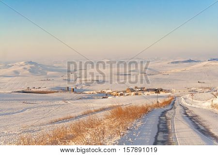 RURAL LANDSCAPE WINTER.Between Apulia and Basilicata. snowy hills landscape with farmhouses. -ITALY- .