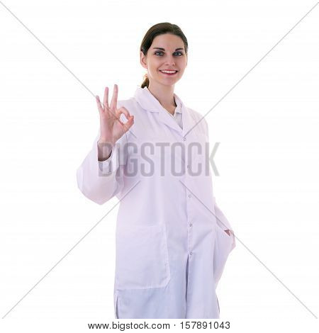 Smiling female doctor assistant scientist in white coat over white isolated background showing OK sign, healthcare, profession, science and medicine concept