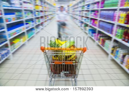 Shopping Cart Full of Groceries in a Supermarket