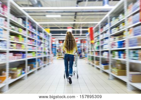 Portrait of a Woman Pushing a Shopping Cart in a Supermarket