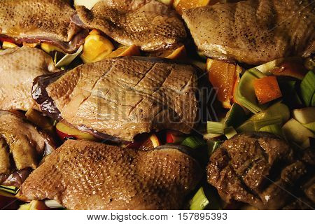 closeup raw marinated duck meat with vegetables