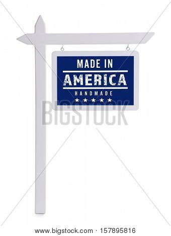 Signboard with text MADE IN AMERICA HANDMADE on white background. Manufacturing quality concept.