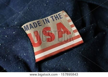 Garment label with text MADE IN THE USA, closeup. Manufacturing quality concept.