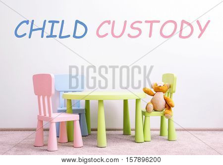 Children furniture with toy. Text CHILD CUSTODY on wall background