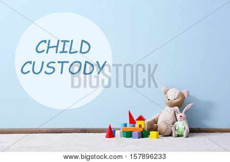 Children toys near wall. Text CHILD CUSTODY on blue background
