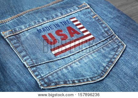Printed text MADE IN THE USA on jeans pocket, closeup. Manufacturing quality concept.