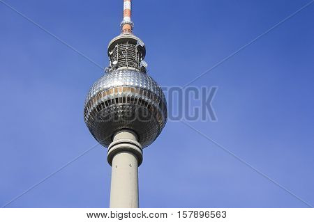 The TV Tower with blue sky on the background in Berlin Germany.