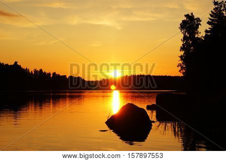 sunset on the lake in middle Finland during the summer solstice
