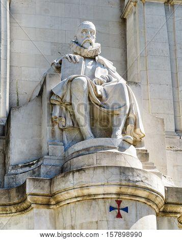 Closeup View Of The Stone Sculpture Of Miguel De Cervantes On The Square Of Spain (plaza De Espana)