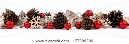 Christmas Border With Rustic Wood Tree Ornaments, Baubles And Pine Cones Isolated On A White Backgro