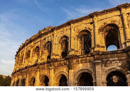 Arena of Nimes at sunset. Nimes Occitanie France.
