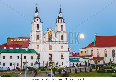 Moonrise over Cathedral Of Holy Spirit In Minsk. Famous and Main Orthodox Church Of Belarus in Minsk