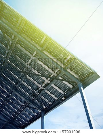 Solar energy battery view from below against clear blue sky on a spring day
