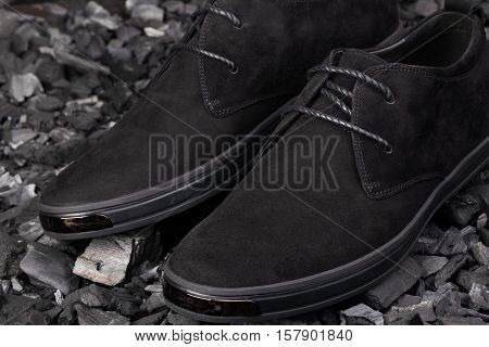 Black Man's Shoes On Gray Background, Selective Focus.