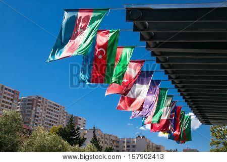 Azerbaijan and other flags waving on the wind in Baku. Azerbaijan. Europe.