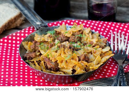 Pasta farfalle with ground beef and tomato sauce a la bolognese