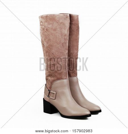 stylish female beige boots over white background