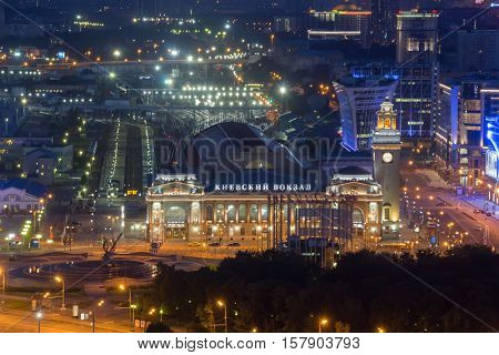 Kievsky railway station at night in Moscow. Russian Railways is among three largest transport companies in world, text - Kievsky railway station