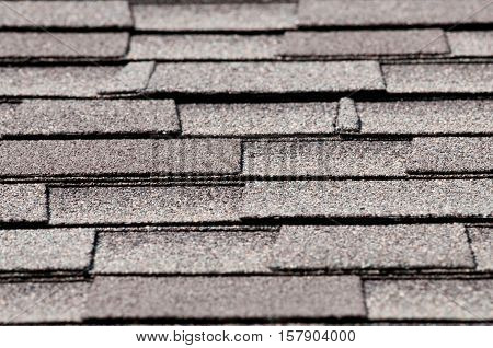 Close up view of shingles on a roof of a house.