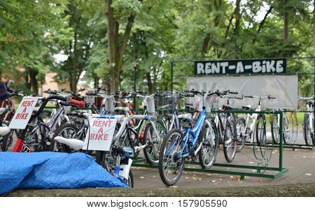 Vrnjacka Banja Serbia - August 23 2016: Parked colorful bicycles for a rent in a park