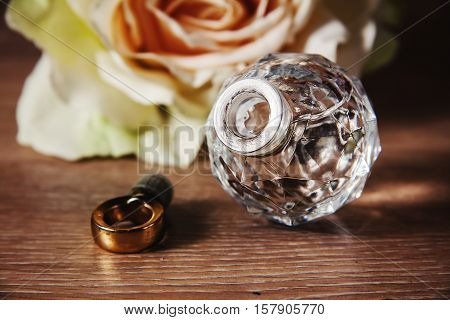 Perfumery. Retro female bootle of perfume with rose