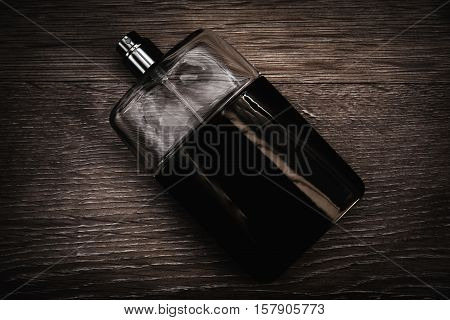 stylish men's fragrance in a wooden background