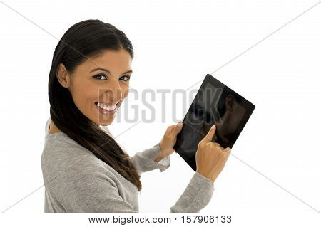 young happy and excited hispanic woman using digital tablet pad smiling isolated on white background in business success and internet communication concept
