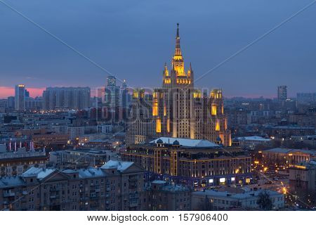 Residential building on square Kudrinskaya (Stalin skyscraper) with illumination at evening in Moscow, Russia
