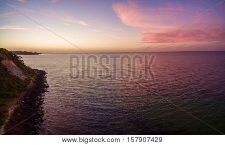 Aerial Panorama Of Magnificent Purple Sunset Over Ocean, Australia