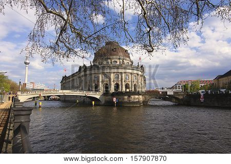 View on Bode Museum TV-Tower and the river Sprea with a touristic boat in Berlin Germany.