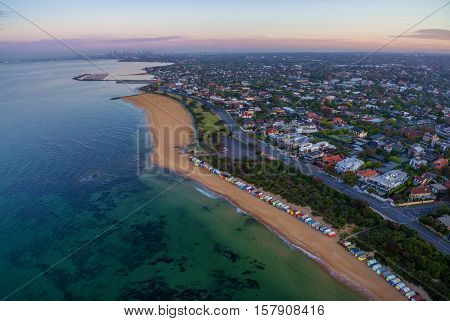 Aerial View Of Sunrise At Brighton Beach Coastline With Beach Boxes, And Cbd In The Distance. Melbou