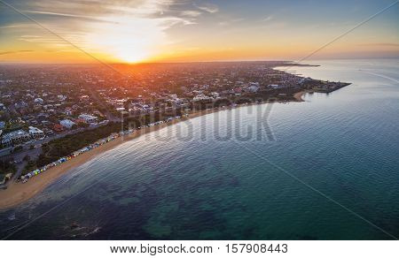 Aerial View Of Sunrise At Brighton Beach Showing The Suburb And Bathing Boxes. Melbourne, Australia