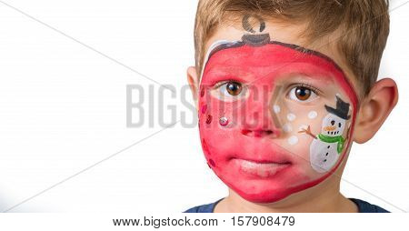 Lovely Adorable Kid With Paintings On His Face As A Bauble With Snow And Snowman For Christmas