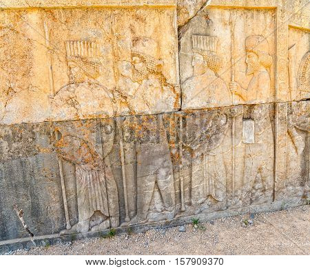 Guardians also known as the Immortals holding a spear, relief detail on the stairway facade of the Apadana at the old city Persepolis.