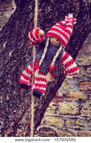 Rag doll hanging on a rope vintage toning
