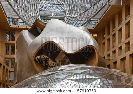 BERLIN GERMANY - JULY 2015: Atrium of the DZ Bank building in Berlin. Pariser Platz 3 Mitte central Berlin. It is an office conference and residential building designed by architect Frank Gehry completed in 2000
