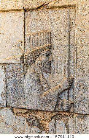 Stone bas-relief of residents of historical empire carved on the stairway facade of the Apadana at the old city Persepolis, capital of the Achaemenid Empire.