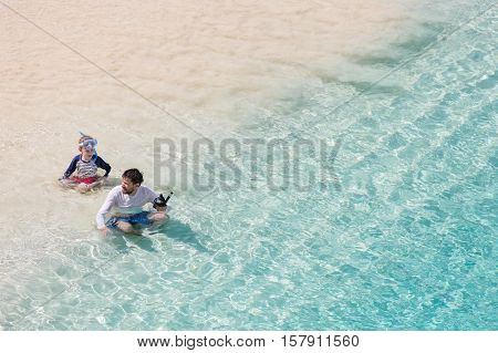 family of two enjoying snorkeling at caribbean vacation active and healthy lifestyle