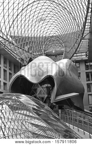 BERLIN GERMANY - JULY 2015: Atrium of the DZ Bank building in Berlin. Pariser Platz 3 Mitte central Berlin. It is an office conference and residential building designed by architect Frank Gehry completed in 2000. Black and white photograph